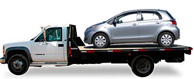Toyota Yaris riding on top of flatbed truck